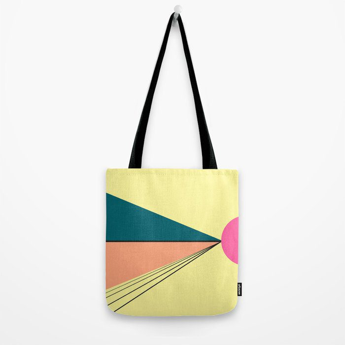 Yellow totebag with peach and turquoise design with hot pink circle.